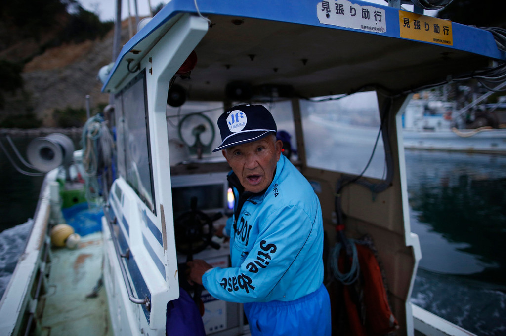 """. 80-year-old fisherman Shohei Yaoita stands aboard his boat \""""Shoei Maru\"""", about 30 km (19 miles) south of Fukushima Daiichi nuclear power plant, Fukushima prefecture May 26, 2013. Yaoita\'s catch will be used to test for radioactive contamination in the waters near the nuclear facility. Commercial fishing has been banned near the tsunami-crippled nuclear complex since the March 2011 tsunami and earthquake. The only fishing that still takes place is for contamination research, and is carried out by small-scale fishermen contracted by the government. Picture taken May 26, 2013. REUTERS/Issei Kato"""