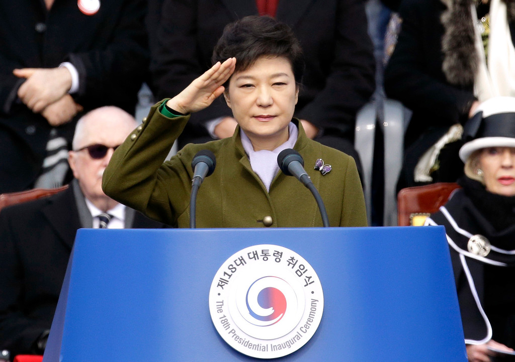 . South Korea\'s new President Park Geun-hye salutes during her inauguration ceremony as the 18th South Korean president, at the National Assembly in Seoul, South Korea, Monday, Feb. 25, 2013. Park took office as South Korea\'s first female president Monday, returning to the presidential mansion she had known as the daughter of a dictator, and where she will respond to volatile North Korea, which tested a nuclear device two weeks ago. (AP Photo/Lee Jin-man)