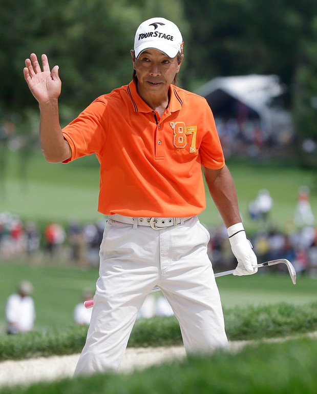 . Kohki Idoki, of Japan, waves after a bunker shot on the ninth hole during the first round of the PGA Championship golf tournament at Oak Hill Country Club, Thursday, Aug. 8, 2013, in Pittsford, N.Y. (AP Photo/Charlie Neibergall)
