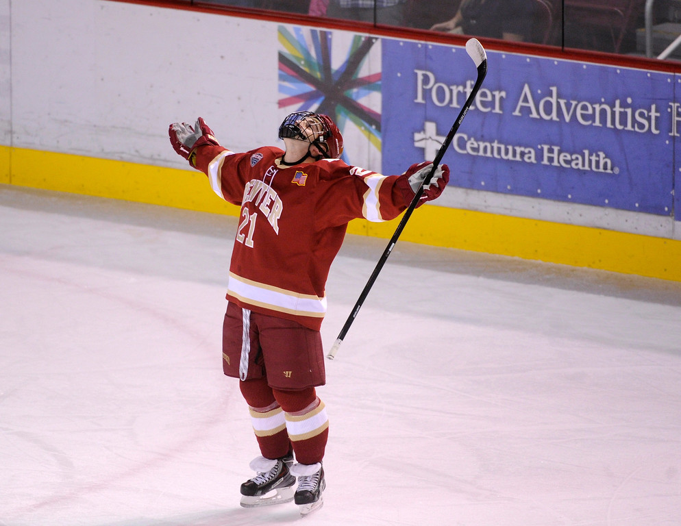 . DENVER, CO. - OCTOBER 25: Denver defenseman Joey LaLeggia (21) took the spotlight following his goal on the penalty play in the first period Friday night. The University of Denver hockey team hosted Niagara at Magness Arena Friday night, October 25, 2013. Photo By Karl Gehring/The Denver Post