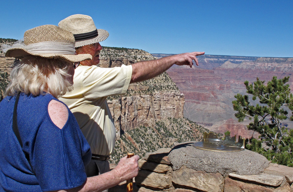 . Karen and Tom Jacobs, of Carrollton, Texas, look out over the South Rim of the Grand Canyon on Tuesday, Sept. 30, 2013. National parks would close Tuesday if an agreement is not reached on the federal budget. (AP Photo/Felicia Fonseca)