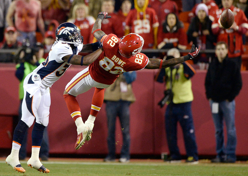 . Denver Broncos cornerback Kayvon Webster (36) puts a push on Kansas City Chiefs wide receiver Dwayne Bowe (82) keeping him from catching the ball during the fourth quarter December 1, 2013 at Arrowhead Stadium.  (Photo by John Leyba/The Denver Post)