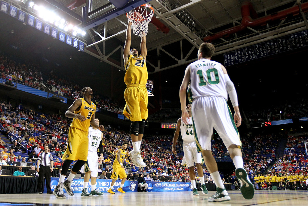 . LEXINGTON, KY - MARCH 21:  Laurence Bowers #21 of the Missouri Tigers dunks the ball against Wes Eikmeier #10 of the Colorado State Rams during the second round of the 2013 NCAA Men\'s Basketball Tournament at the Rupp Arena on March 21, 2013 in Lexington, Kentucky.  (Photo by Andy Lyons/Getty Images)