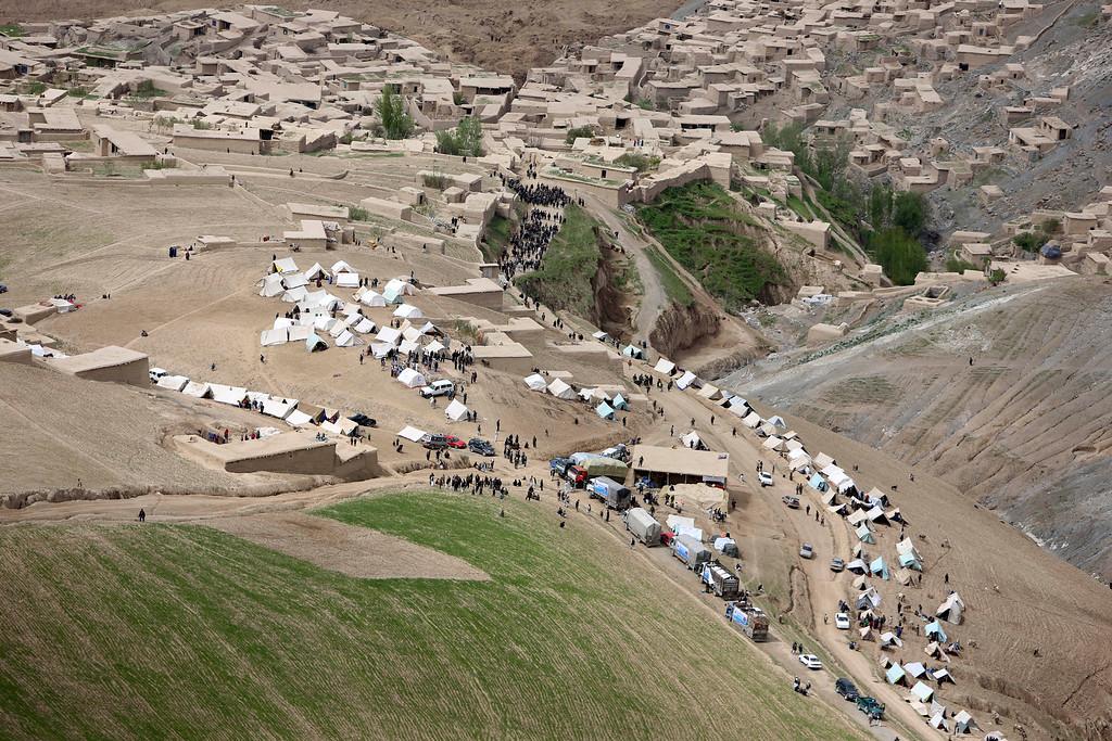 . Survivors walk near the site of Friday\'s landslide that buried Abi Barik village in Badakhshan province, northeastern Afghanistan, Monday, May 5, 2014.  (AP Photo/Rahmat Gul)