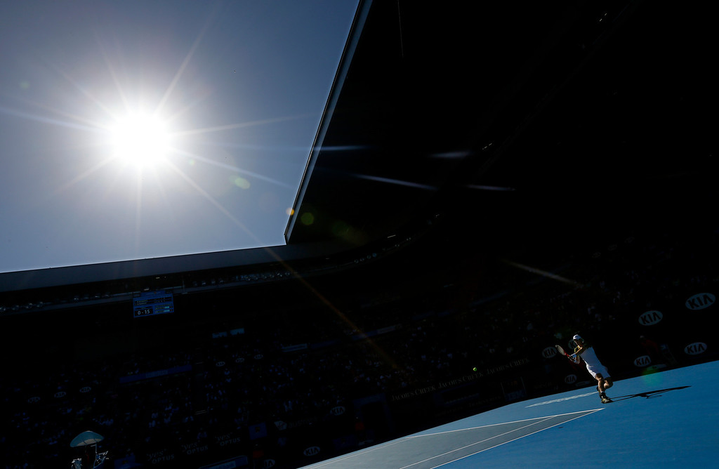 . Britain\'s Andy Murray makes a backhand return to Lithuania\'s Ricardas Berankis during their third round match at the Australian Open tennis championship in Melbourne, Australia, Saturday, Jan. 19, 2013. (AP Photo/Andy Wong, File)