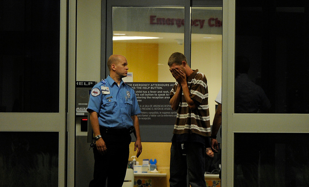 . A man arrives at Children\'s Hospital in Aurora, CO, Friday, July 20, 2012.  Fourteen people were killed and about 50 were injured early Friday when shots rang out at an Aurora movie theater during a premiere showing of the new Batman movie. Craig F. Walker, The Denver Post