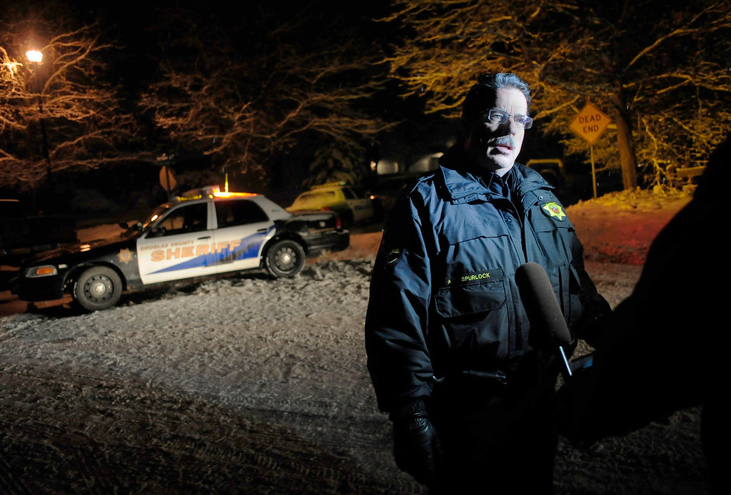 . Douglass County Undersheriff Tony Spurlock speaks with a member of the press near the scene of a shooting in the 500 block of Fox Hunt Circle in Highlands Ranch, Colorado, Friday, January 31, 2014. Officials on the scene confirmed two fatalities in the incident, which was reported around 7:30 p.m. (Photo By Brenden Neville / Special to The Denver Post)