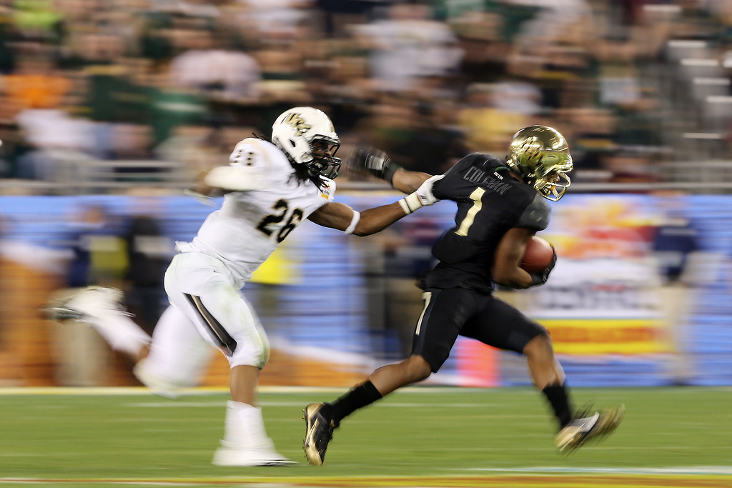 . Corey Coleman #1 of the Baylor Bears is tackled by Clayton Geathers #26 of the UCF Knights during the Tostitos Fiesta Bowl at University of Phoenix Stadium on January 1, 2014 in Glendale, Arizona.  (Photo by Christian Petersen/Getty Images)