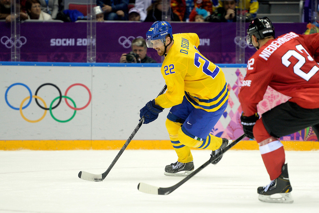 . Sweden\'s Daniel Sedin brings the puck up the ice against Switzerland during the action at Bolshoy Arena. Sochi 2014 Winter Olympics on Friday, February 14, 2014. (Photo by AAron Ontiveroz/The Denver Post)