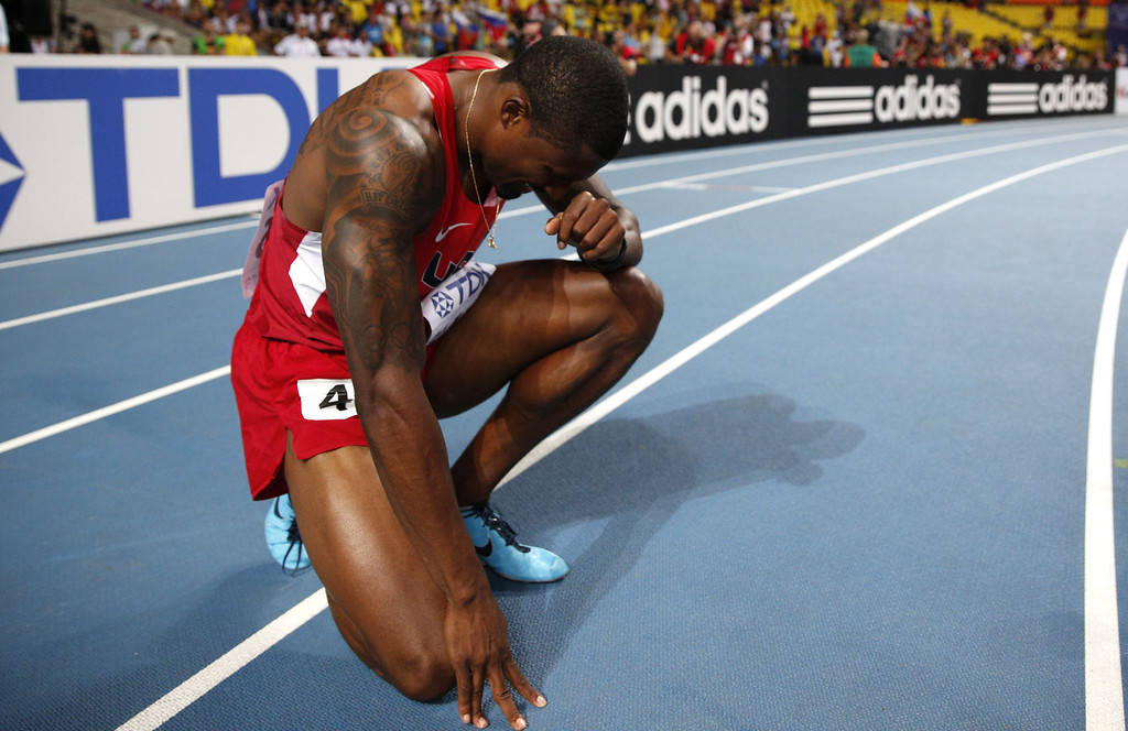 . US\'s David Oliver reacts after winning the men\'s 110 meters hurdles final at the 2013 IAAF World Championships at the Luzhniki stadium in Moscow on August 12, 2013. AFP PHOTO / ADRIAN DENNIS/AFP/Getty Images
