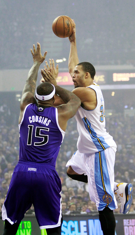 . Denver Nuggets center JaVale McGee, right, shoots over Sacramento Kings center DeMarcus Cousins during the first quarter of an NBA basketball game in Sacramento, Calif., Wednesday, Oct. 30, 2013. (AP Photo/Rich Pedroncelli)