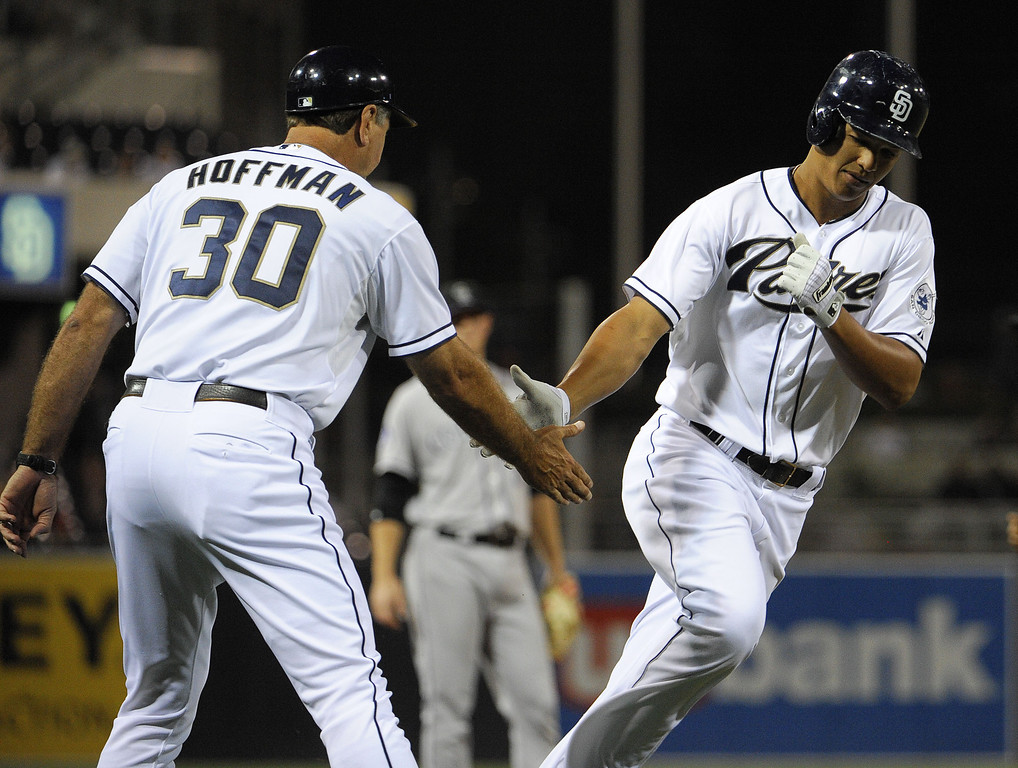 . SAN DIEGO, CA - SEPTEMBER 6:  Will Venable #25 of the San Diego Padres is congratulated by third base coach Glenn Hoffman #30 after he hit a solo home run during the first inning of a baseball game against the Colorado Rockies at Petco Park on September 6, 2013 in San Diego, California.  (Photo by Denis Poroy/Getty Images)