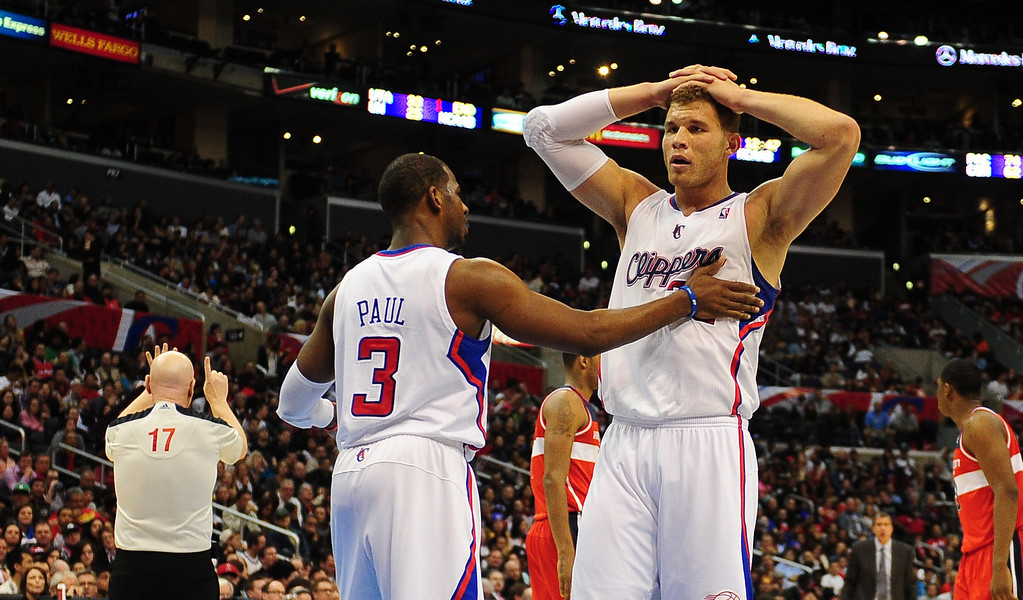 . Blake Griffin of the Los Angeles Clippers reacts to being called for a foul against the Washington Wizards as teammate Chris Paul offers support during their NBA game in Los Angeles on January 19, 2013. AFP PHOTO / Frederic J. BROWNFREDERIC J. BROWN/AFP/Getty Images