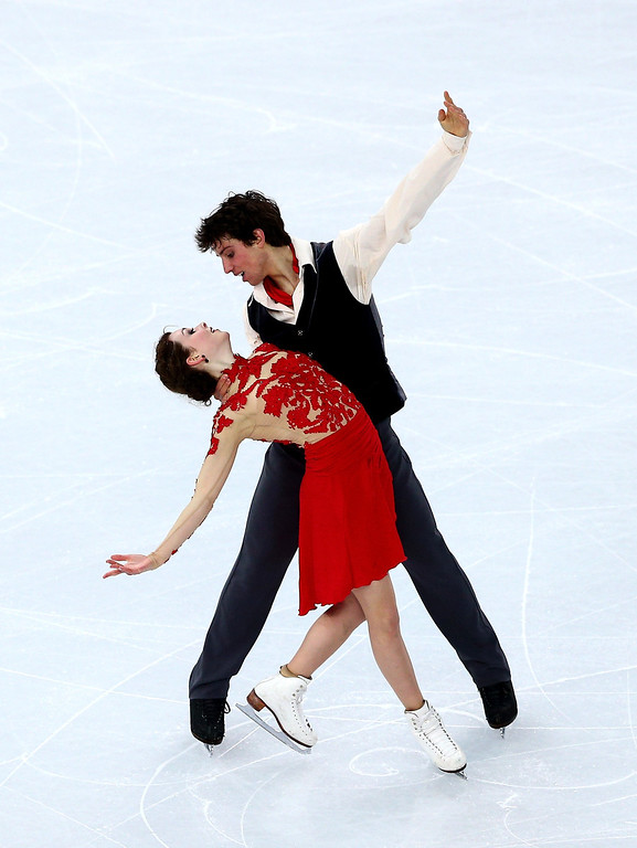 . Alexandra Paul and Mitchell Islam of Canada compete in the Figure Skating Ice Dance Free Dance on Day 10 of the Sochi 2014 Winter Olympics at Iceberg Skating Palace on February 17, 2014 in Sochi, .  (Photo by Clive Mason/Getty Images)