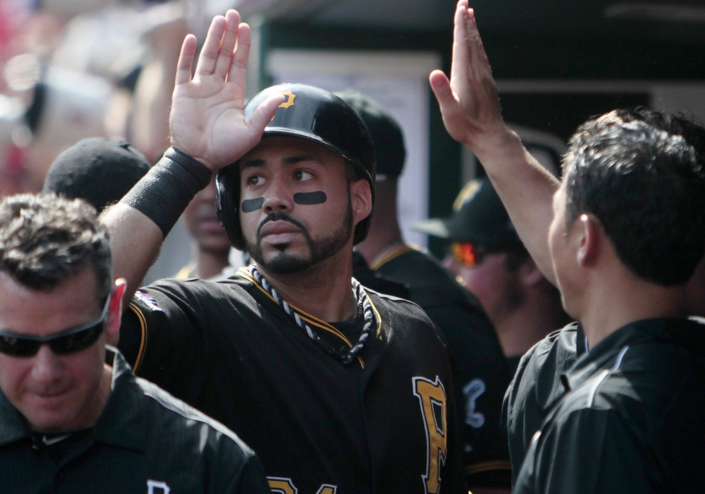 . The Pittsburgh Pirates\' Pedro Alvarez is congratulated by his teammates after his home run against the St. Louis Cardinals in Game 2 of the National League Divisional Series at Busch Stadium in St. Louis, Missouri, Friday, October 4, 2013. The Pirates beat the Cardinals, 7-1. (Zia Nizami/Belleville News-Democrat/MCT)