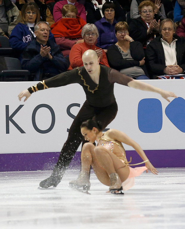. Mari Vartmann of Germany falls as she and Aaron Van Cleave perform their free skating program at the ISU World Figure Skating Championships in London, March 15, 2013. REUTERS/Mark Blinch