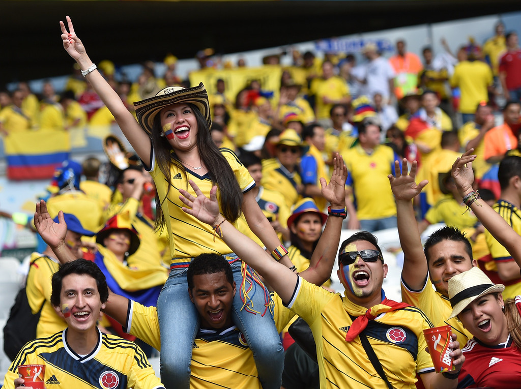 . Colombian supporters wait for the start of a Group C football match between Colombia and Greece at the Mineirao Arena in Belo Horizonte during the 2014 FIFA World Cup on June 14, 2014.   AFP PHOTO / ARIS MESSINIS