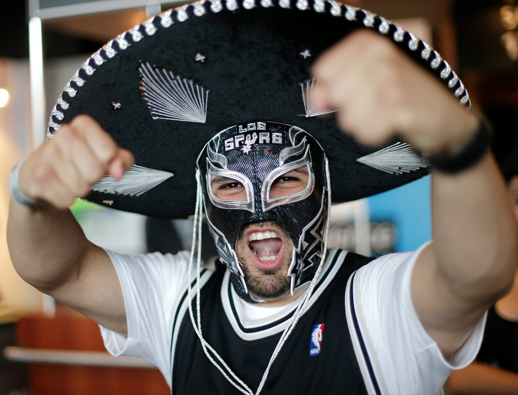 . San Antonio Spurs fan Ezra Castro shows his support for the team before Game 4 of the NBA Finals basketball series against the Miami Heat, Thursday, June 13, 2013, in San Antonio. (AP Photo/Eric Gay)