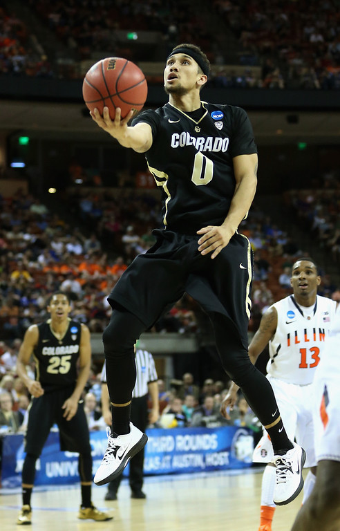 . AUSTIN, TX - MARCH 22:  Askia Booker #0 of the Colorado Buffaloes lays up against the Illinois Fighting Illini during the second round of the 2013 NCAA Men\'s Basketball Tournament at The Frank Erwin Center on March 22, 2013 in Austin, Texas.  (Photo by Ronald Martinez/Getty Images)