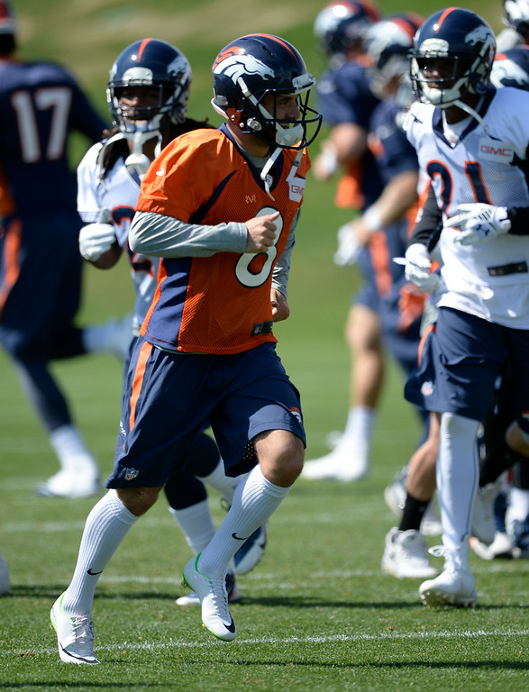 . Denver Broncos kicker Mitch Ewald (8) heads to drills during practice August 25, 2014 at Dove Valley.(Photo by John Leyba/The Denver Post)