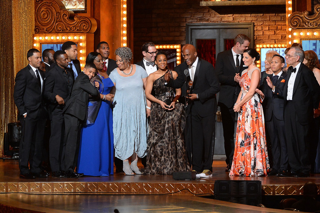 . Director Kenny Leon and cast accepts the award for Best Revival of a Play for A Raisin in the Sun onstage during the 68th Annual Tony Awards at Radio City Music Hall on June 8, 2014 in New York City.  (Photo by Theo Wargo/Getty Images for Tony Awards Productions)
