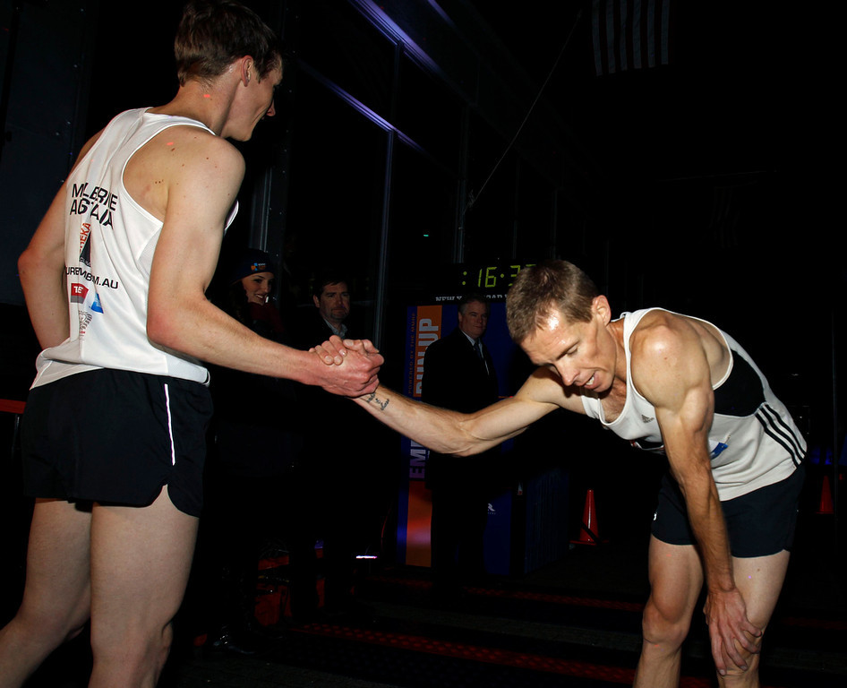 . Mark Bourne of Australia congratulates Darren Wilson (R) also of Australia after the two finished first and second in the 36th Empire State Building Run-Up running race in New York, February 6, 2013. Competitors run up 1,576 steps and 1,050 feet in a stairwell from the ground floor to the 86th floor observation deck.   REUTERS/Adam Hunger