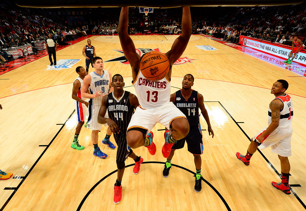 . Cleveland Cavaliers Tristan Thompson (13) hangs on the rim after a dunk during the first half of the NBA BBVA Rising Star Challenge basketball game in Houston, Texas, February 15, 2013. REUTERS/Bob Donnan/Pool