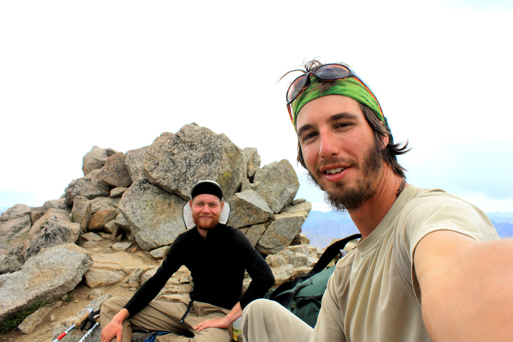 . Luke DeMuth, right, and Junaid Dawud rest atop Mt. Massive in the Sawatch Range in early September. The pair have hiked 1,300 miles and climbed 57 of the state\'s 58 14,000-foot peaks and plan to finish their 70-day mission Sunday on Longs Peak.