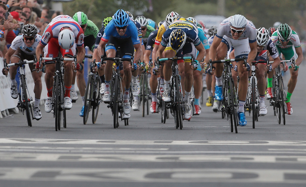 . Marcel Kittel of Germany, right in white, sprints towards the finish line ahead of Alexander Kristoff of Norway, second place and second left, and Danny van Poppel of The Netherlands, left of Kittel and third place, to win the first stage of the Tour de France cycling race over 213 kilometers (133 miles) with start in Porto Vecchio and finish in Bastia, Corsica island, France, Saturday June 29, 2013. (AP Photo/Christophe Ena)