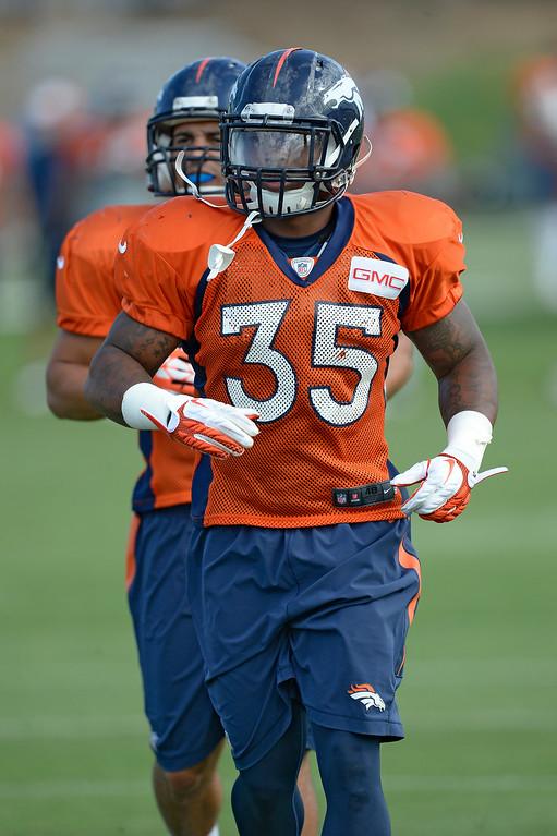 . Denver Broncos running back Kapri Bibbs (35) runs through drills on day 12 of the Denver Broncos 2014 training camp August 5, 2014 at Dove Valley. (Photo by John Leyba/The Denver Post)