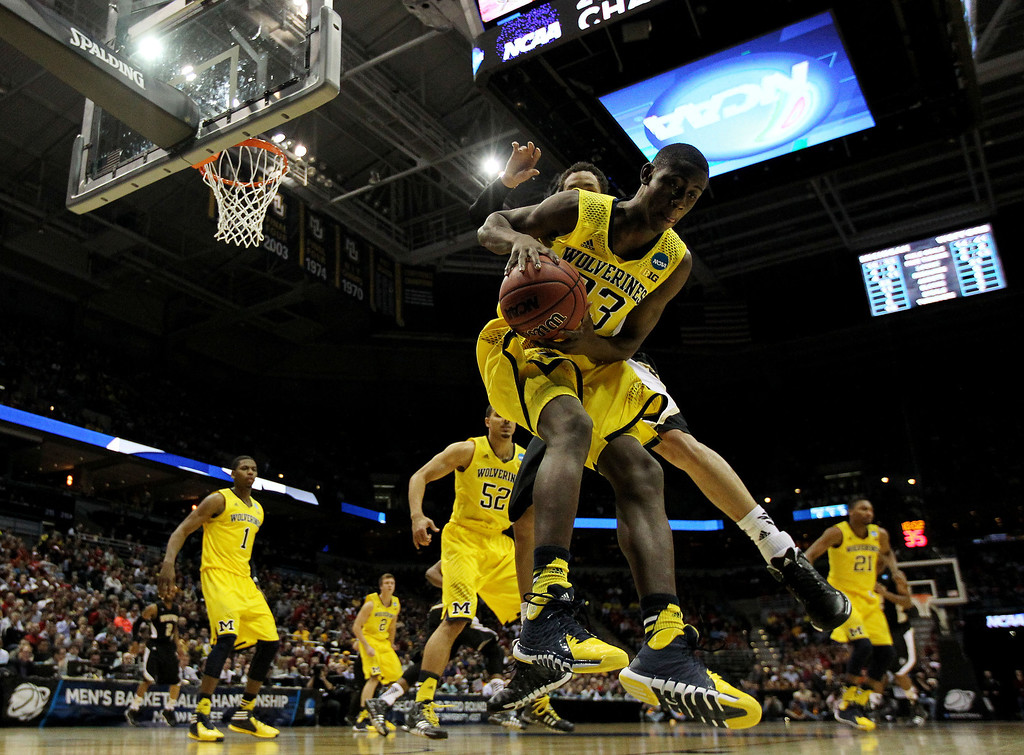 . Caris LeVert #23 of the Michigan Wolverines rebounds against the Wofford Terriers in the second half during the second round of the 2014 NCAA Men\'s Basketball Tournament at BMO Harris Bradley Center on March 20, 2014 in Milwaukee, Wisconsin.  (Photo by Jonathan Daniel/Getty Images)