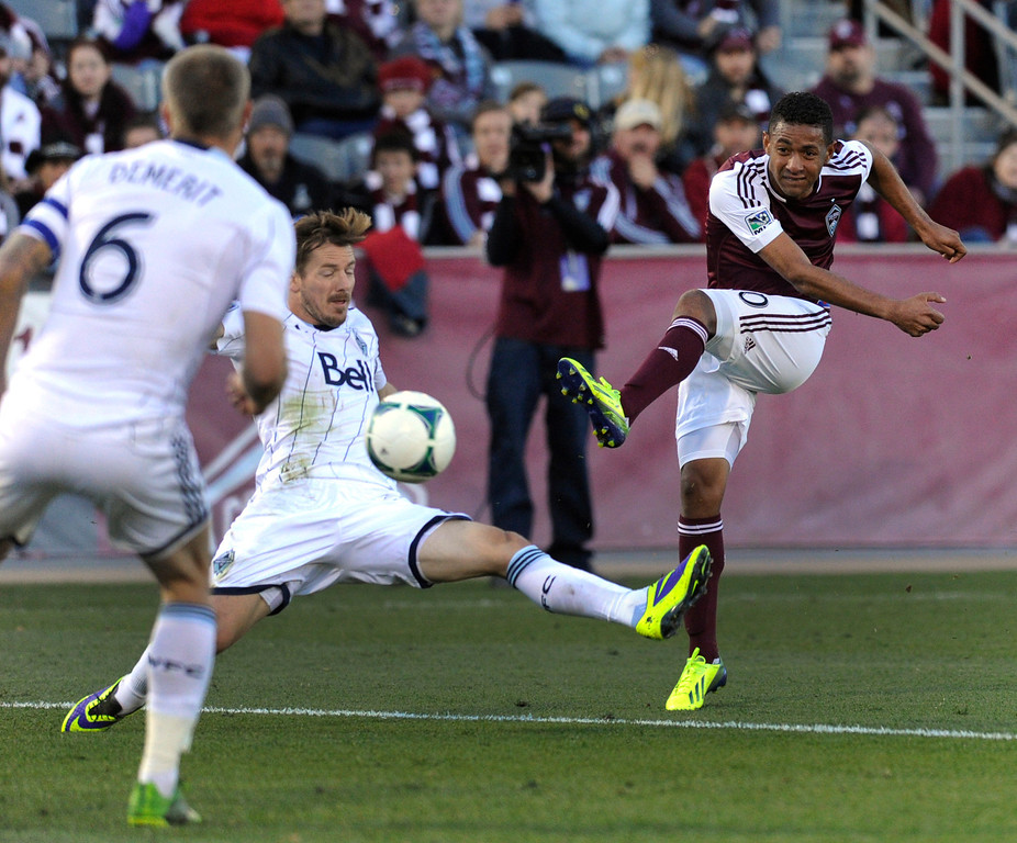 . COMMERCE CITY, CO. - OCTOBER 19: Colorado forward Gabriel Torres (30) kicked the game winning goal past Vancouver defenders in the second half. The Colorado Rapids defeated the Vancouver Whitecaps 3-2 at Dick\'s Sporting Goods Park Saturday, October 19, 2013. Photo By Karl Gehring/The Denver Post