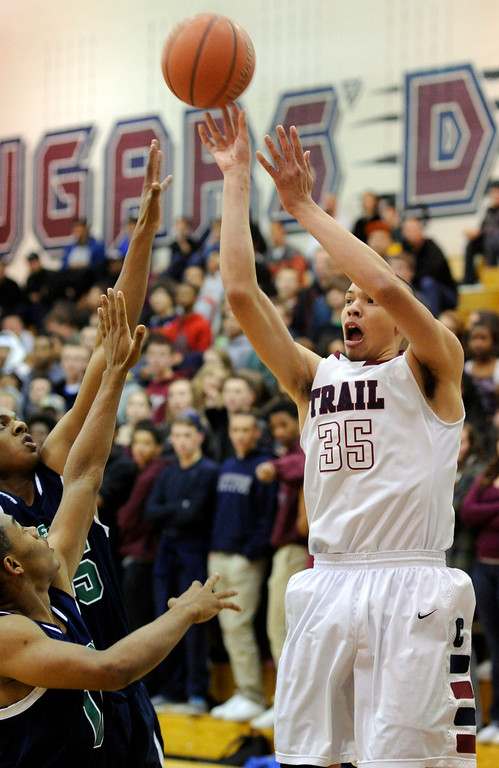 . Cougars senior forward Drick Bernstine (35) let go of a shot from the corner early in the first quarter. The Cherokee Trail boy\'s basketball team defeated Overland 59-57 Friday night, January 11, 2013. Karl Gehring/The Denver Post