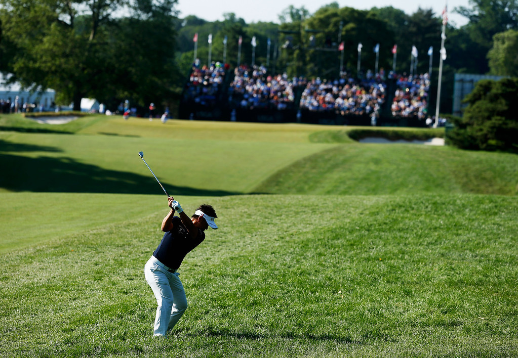 . Hiroyuki Fujita of Japan hits an approach shot on the 18th hole during the continuation of Round Two of the 113th U.S. Open at Merion Golf Club on June 15, 2013 in Ardmore, Pennsylvania.  (Photo by Scott Halleran/Getty Images)