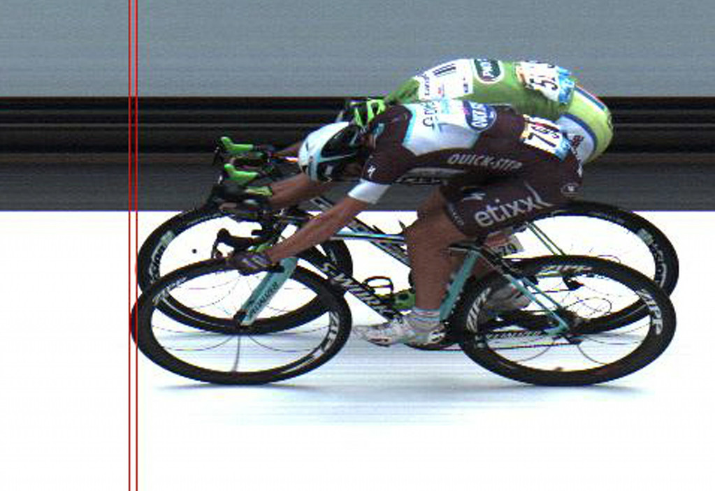 . In this photo finish image released by ASO Italy\'s Matteo Trentin, front, crosses the finish line ahead of second place Peter Sagan of Slovakia, rear, to win the seventh stage of the Tour de France cycling race over 234.5 kilometers (145.7 miles) with start in Epernay and finish in Nancy, France, Friday, July 11, 2014. (AP Photo/ASO, HO)