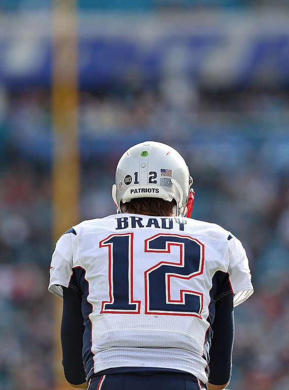 . Tom Brady #12 of the New England Patriots looks on during a game against the Jacksonville Jaguars at EverBank Field on December 23, 2012 in Jacksonville, Florida.  (Photo by Mike Ehrmann/Getty Images)