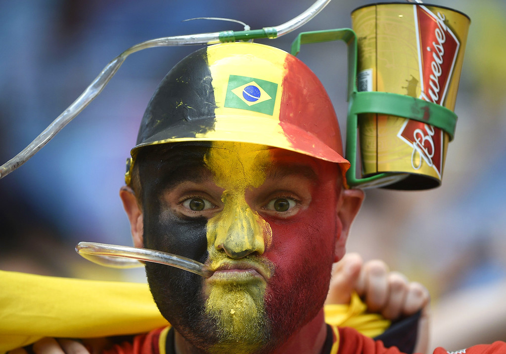 . A Belgium\'s fan drinks beer as he waits for the start of the Group H football match between Belgium and Russia at the Maracana Stadium in Rio de Janeiro during the 2014 FIFA World Cup on June 22, 2014.  MARTIN BUREAU/AFP/Getty Images