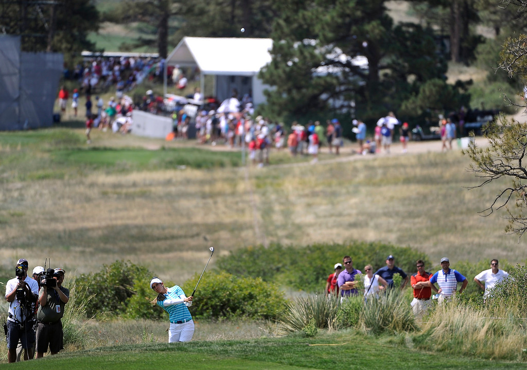 . PARKER, CO - Aug.17: Team Europe\'s Azahara Munoz hits her ball up the fairway. The 2013 Solheim Cup takes place at the Colorado Golf Club with the USA taking on Europe in the Saturday morning Foursomes Match. (Photo By Kathryn Scott Osler/The Denver Post)