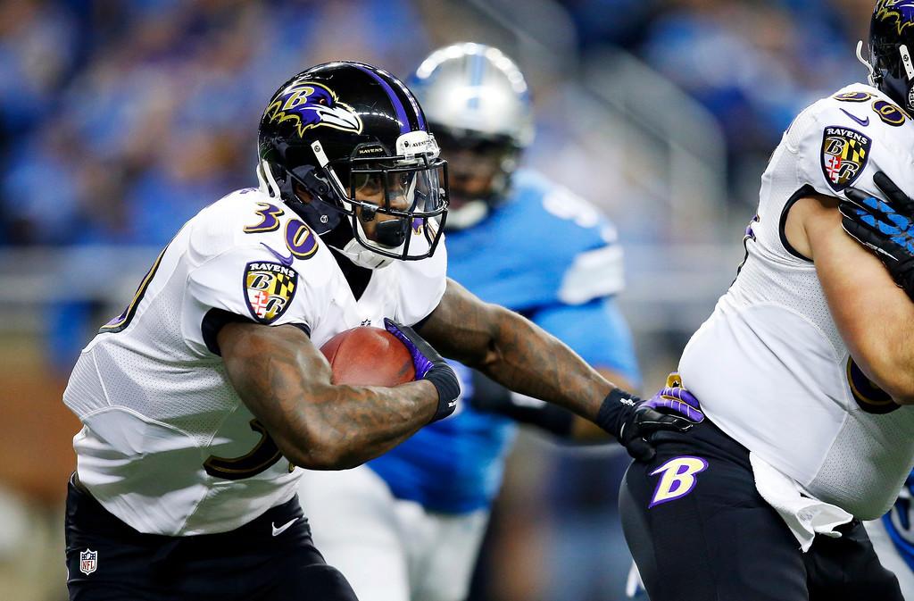. Baltimore Ravens running back Bernard Pierce (30) runs during the first quarter of an NFL football game against the Detroit Lions in Detroit, Monday, Dec. 16, 2013. (AP Photo/Rick Osentoski)
