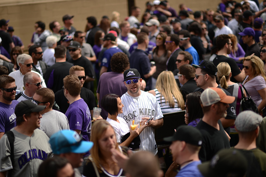 . Fans wait to enter the stadium before the start of the game. The Colorado Rockies took on the San Diego Padres on Opening Day at Coors Field in Denver, Colorado. (Photo by Hyoung Chang/The Denver Post)
