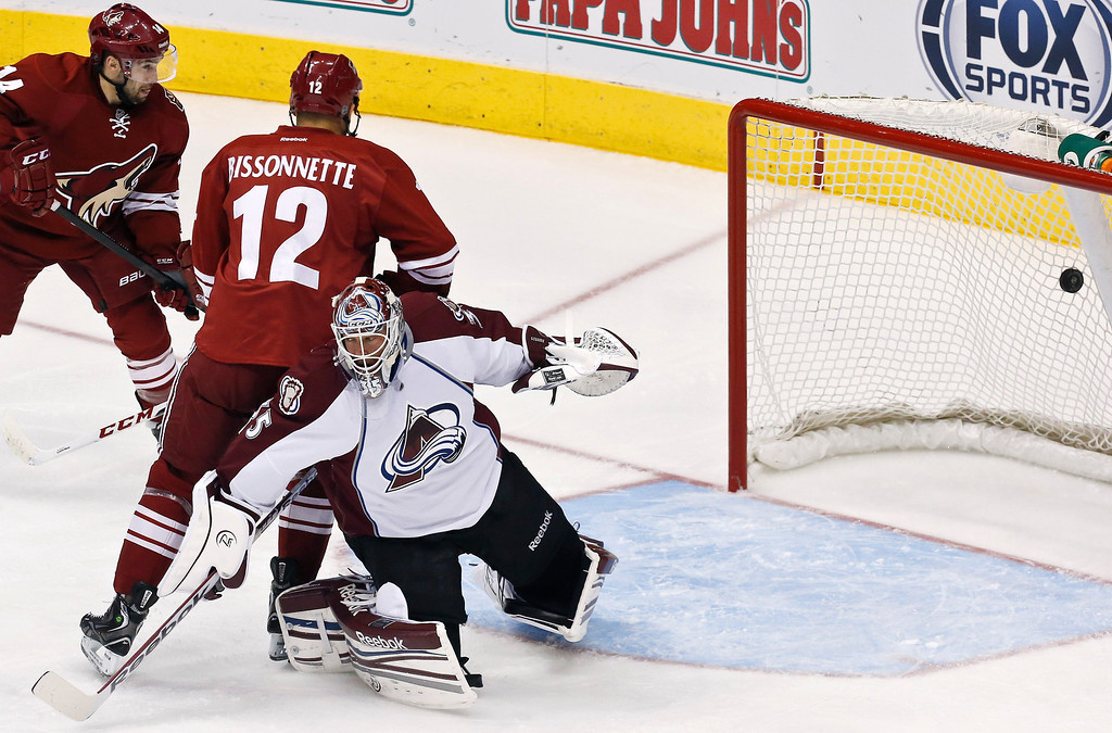 . Colorado Avalanche\'s Jean-Sebastien Giguere (35) gives up a goal to Phoenix Coyotes\' David Schlemko as Coyotes\' Paul Bissonnette (12) and Chris Conner, top left, look on during the first period in an NHL hockey game, on Friday, April 26, 2013, in Glendale, Ariz. (AP Photo/Ross D. Franklin)