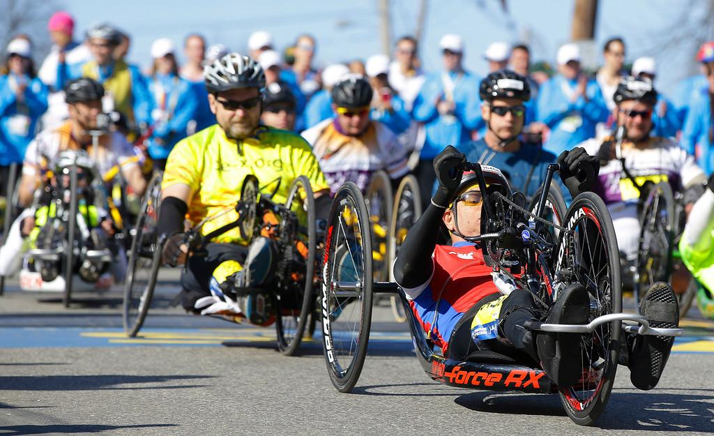 . Participants in thewheelchair division  of the 118th Boston Marathon begin their race Monday, April 21, 2014 in Hopkinton, Mass. (AP Photo/Stephan Savoia)