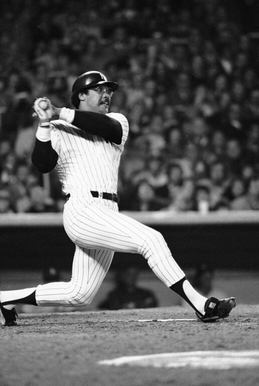 . Yankees\' Reggie Jackson follows through on a swing as he knocks second homer in fifth inning of World Series game in New York, Oct. 18, 1977. Yanks beat Dodgers, 8-4, to win world championship. (AP Photo)