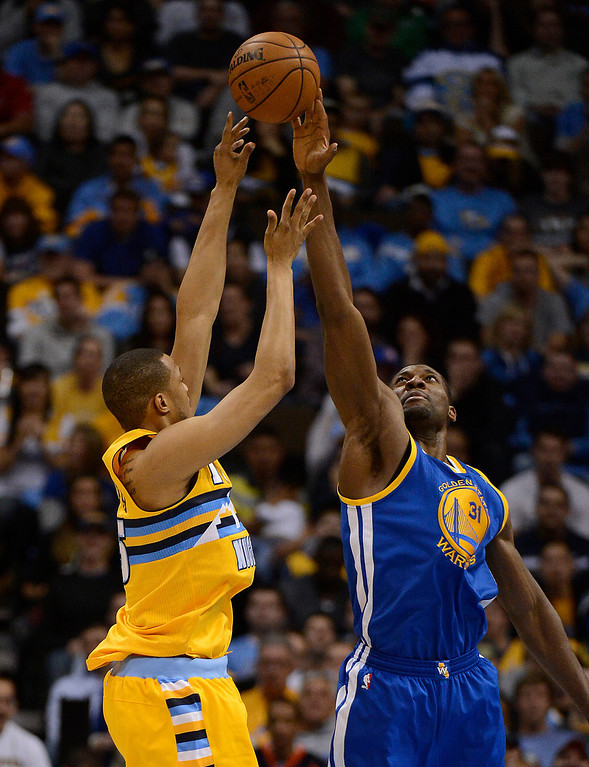 . DENVER, CO. - APRIL 23: Denver Nuggets power forward Anthony Randolph (15) has his shot blocked by Golden State Warriors center Festus Ezeli (31) in the third quarter. The Denver Nuggets took on the Golden State Warriors in Game 2 of the Western Conference First Round Series at the Pepsi Center in Denver, Colo. on April 23, 2013. (Photo by John Leyba/The Denver Post)