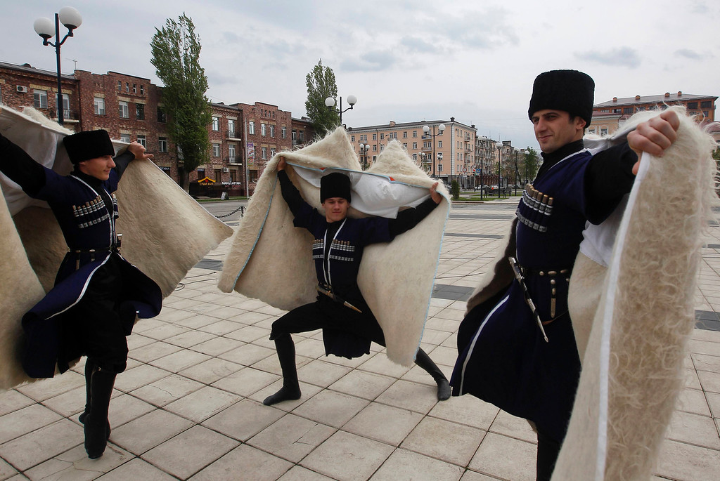 . Members of a Chechen dance group pose for photographers at a government-organised event marking Chechen language day in the centre of the Chechen capital Grozny April 25, 2013. The naming of two Chechens, Dzhokhar and Tamerlan Tsarnaev, as suspects in the Boston Marathon bombings has put Chechnya - the former site of a bloody separatist insurgency - back on the world\'s front pages. Chechnya appears almost miraculously reborn. The streets have been rebuilt. Walls riddled with bullet holes are long gone. New high rise buildings soar into the sky. Spotless playgrounds are packed with children. A giant marble mosque glimmers in the night. Yet, scratch the surface and the miracle is less impressive than it seems. Behind closed doors, people speak of a warped and oppressive place, run by a Kremlin-imposed leader through fear.  Picture taken April 25, 2013.   REUTERS/Maxim Shemetov