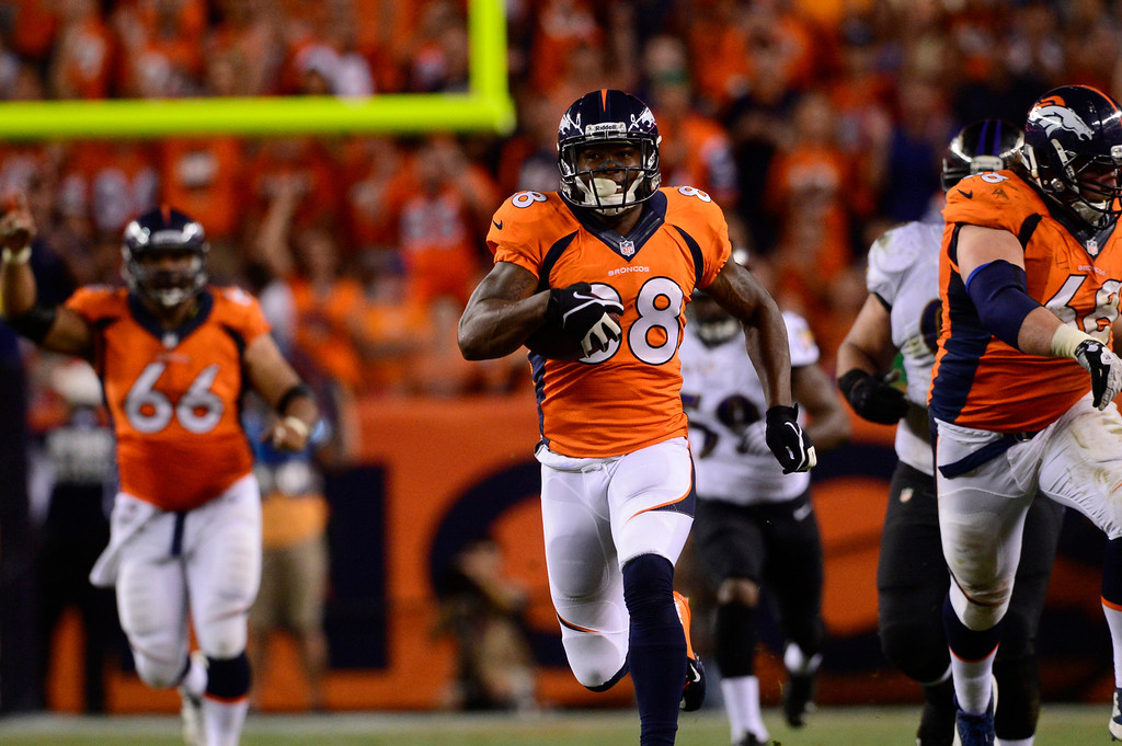 . DENVER, CO - SEPTEMBER 05: Denver Broncos wide receiver Demaryius Thomas (88) catches Denver Broncos quarterback Peyton Manning\'s (18) seventh touchdown pass of the game. The Denver Broncos took on the Baltimore Ravens in the first game of the 2013 season at Sports Authority Field at Mile High in Denver on September 5, 2013. (Photo by AAron Ontiveroz/The Denver Post)