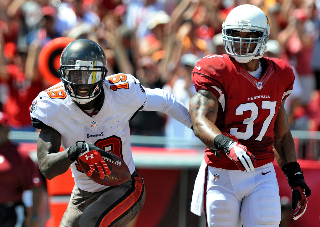 . Tampa Bay Buccaneers wide receiver Mike Williams (19) beats Arizona Cardinals strong safety Yeremiah Bell (37) to the end zone to score a touchdown during the first quarter of an NFL football game Sunday, Sept. 29, 2013, in Tampa, Fla. (AP Photo/Brian Blanco)