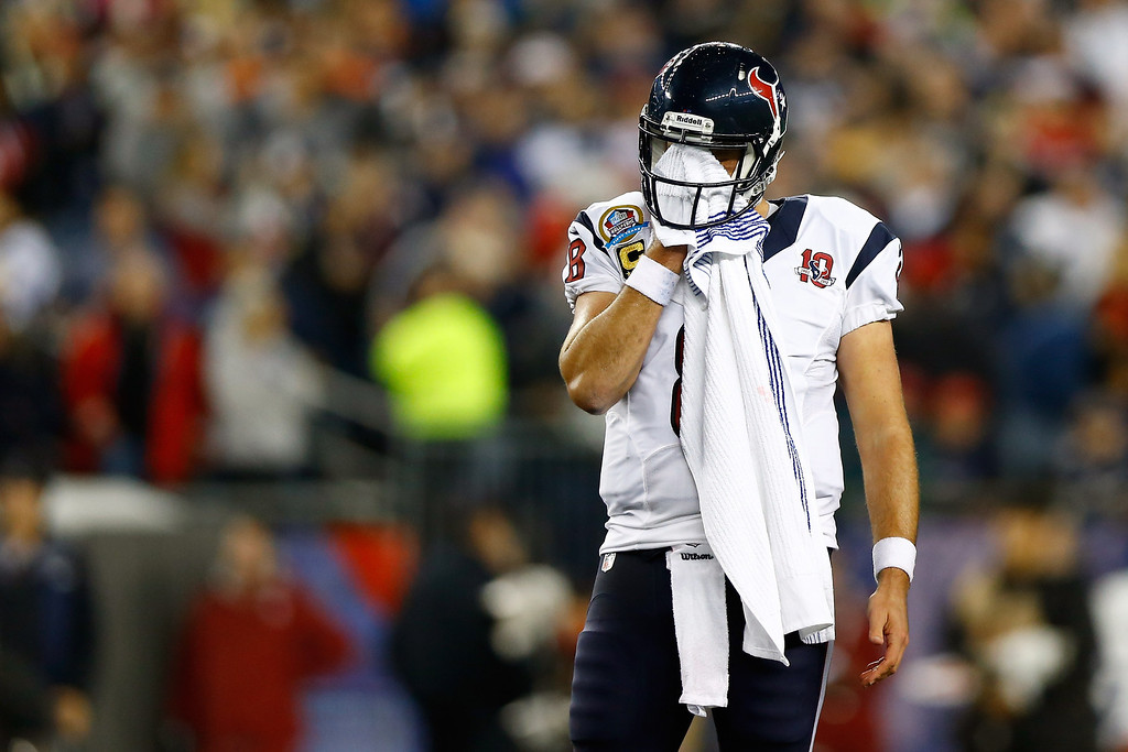 . FOXBORO, MA - DECEMBER 10:  Quarterback Matt Schaub #8 of the Houston Texans wipes his face in the first half while taking on the New England Patriots at Gillette Stadium on December 10, 2012 in Foxboro, Massachusetts.  (Photo by Jared Wickerham/Getty Images)