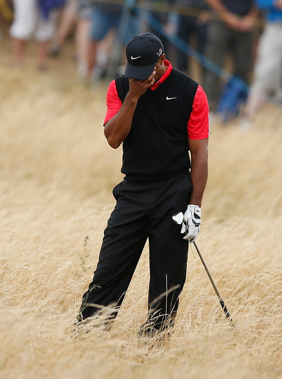 . Tiger Woods of the United States reacts after playing a shot on the 11th hole during the final round of the British Open Golf Championship at Muirfield, Scotland, Sunday July 21, 2013. (AP Photo/Matt Dunham)