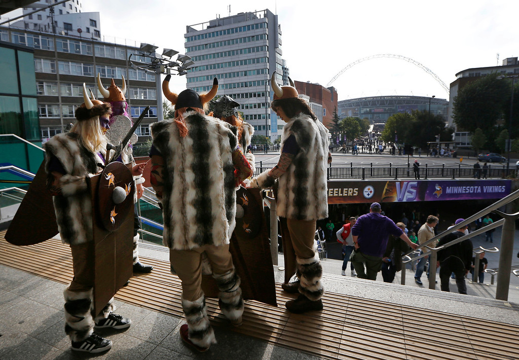 . Minnesota Vikings supporters arrive at Wembley Park underground station ahead of the NFL football game against Pittsburgh Steelers at Wembley Stadium, London, Sunday, Sept. 29, 2013.  (AP Photo/Sang Tan)